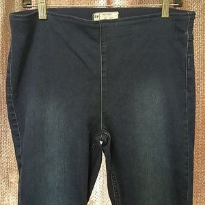Free people pull on stretch  Jean's flared leg